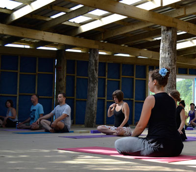 Photo of people doing yoga at Surya Yoga Camp where CreativeCore workshops will be held in May 2015 as Special Event by ryyabread.com