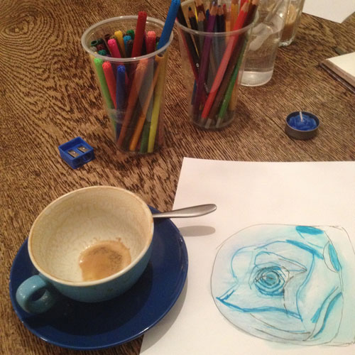 Drawing of blue rose with empty coffee cup and art supplies from CreativeCore workshop at Espressini with Dr RyyA Bread phd by ryyabread.com